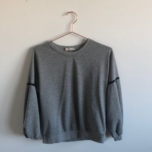 Grey sweatshirt with lace detail and dolman sleeve